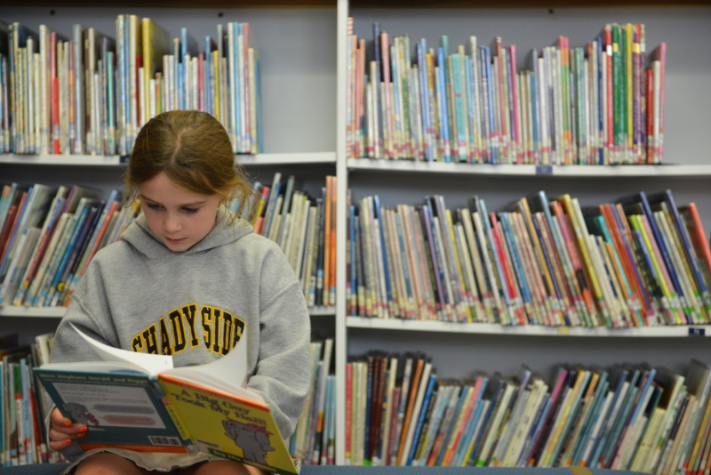 Elementary School Student Reading in Library at Shady Side Academy in Pittsburgh