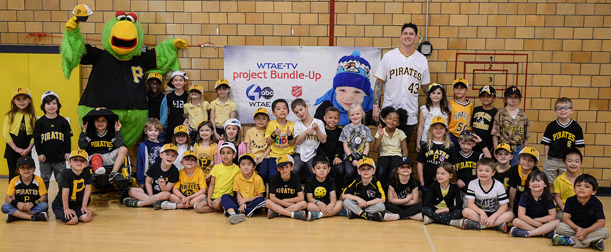 Group photo of kindergarten students with Pirates pitcher Steven Brault and the Pirate Parrot