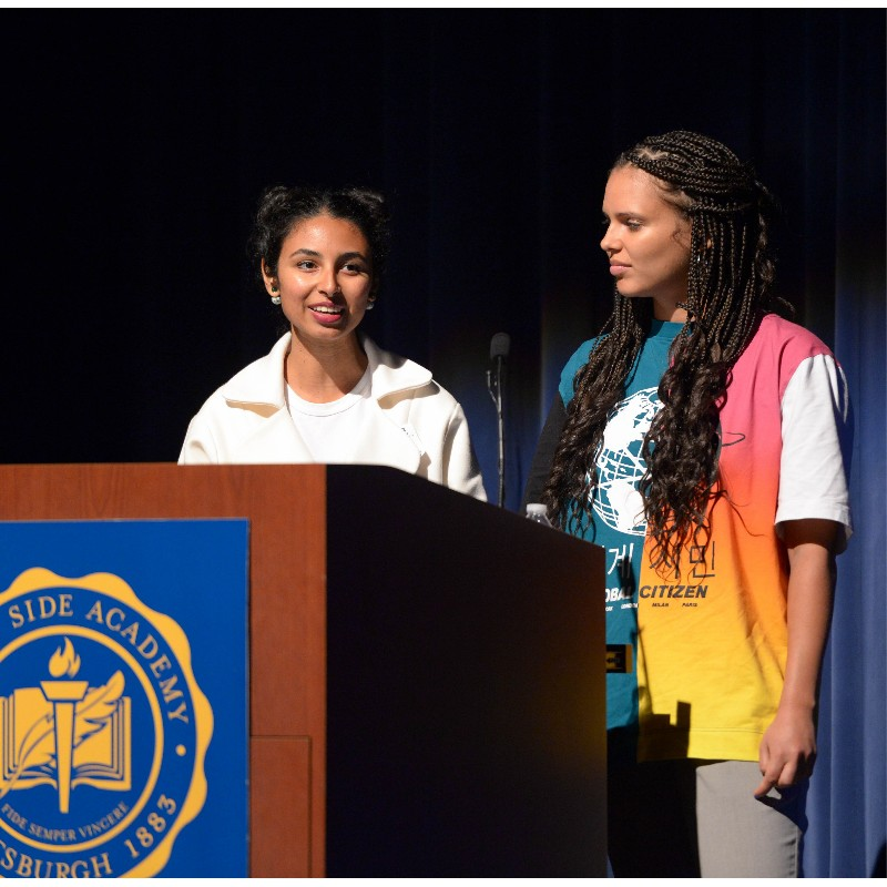 Pooja Tripathi '10 and Dionne van den Berg at assembly