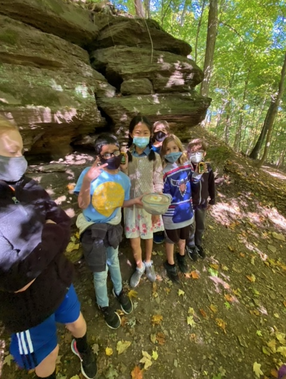 Photo of fifth grade students with the geocache.