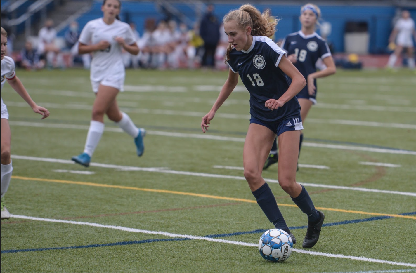 Photo of senior Melissa Riggins playing soccer.